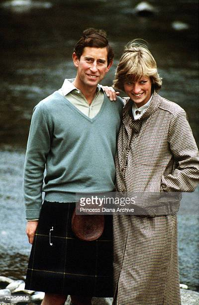 The Prince and Princess of Wales stand by the River Dee on the Balmoral estate during their honeymoon in Scotland September 1981 The Princess wears a...