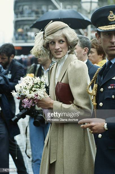 The Prince and Princess of Wales visit an RAF base in Christchurch during a trip to New Zealand, April 1983. The Princess is wearing a Catherine...