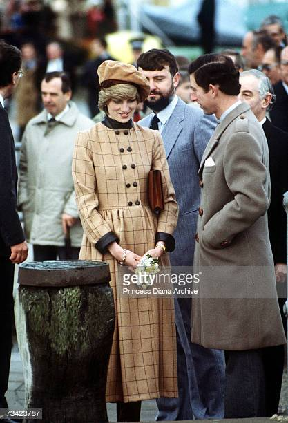 The Prince and Princess of Wales visit Barmouth in Wales November 1982 She wears a suede beret by John Boyd and a coatdress by Arabella Pollen