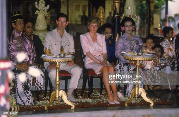 The Prince and Princess of Wales visit the Sultan's palace in Yogyakarta during a visit to Indonesia November 1989 The Princess wears a suit by...