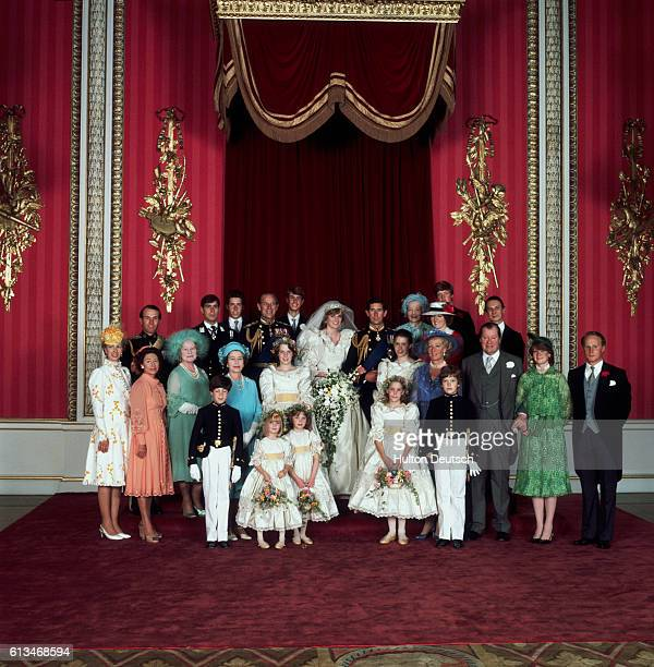 The Prince and Princess of Wales with their families at Buckingham Palace after their marriage at Westminster Abbey.