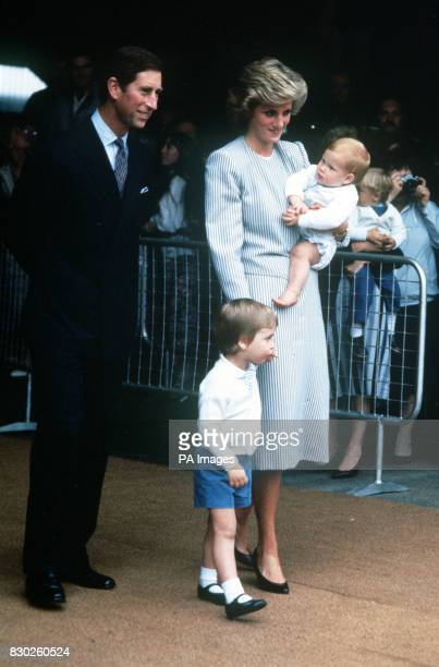The Prince and Princess of Wales with their sons Prince William and Prince Harry prior to boarding the Royal Yacht Britannia at Southampton Docks to...