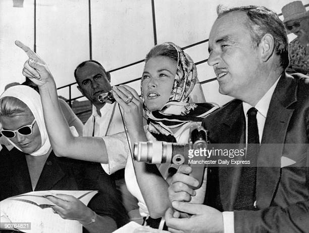 The prince and princess watching the Olympic rowing events at Castelgandolfo in September 1960 Princess Grace�s sister is with them American film...