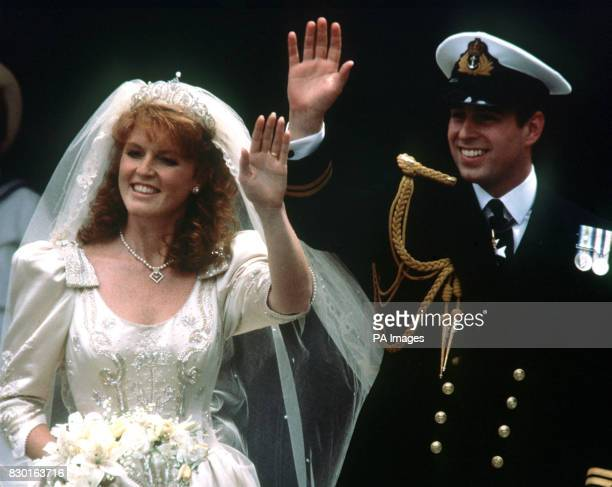 The Prince Andrew and his bride Sarah Ferguson wave to crowds as they leave Westminster Abbey London after their wedding ceremony for Buckingham...