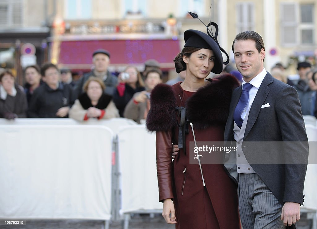 The Prince Felix of Luxembourg and his fiancee Claire Lademacher pose in front of the Saint Epvre Basilica before the wedding of Archduke of Austria Christoph of Habsbourg with Adelaide Drape-Frisc...