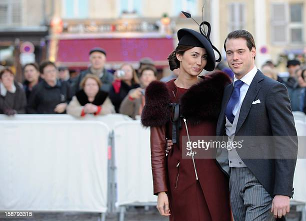 The Prince Felix of Luxembourg and his fiancee Claire Lademacher pose in front of the Saint Epvre Basilica before the wedding of Archduke of Austria...