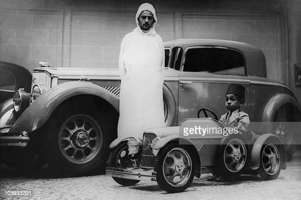 The Prince Moulay Hassan the future King Hassan II of Morocco plays in the1930 in Casablanca in a replica of Frenchmade Panhard limousine He ascended...