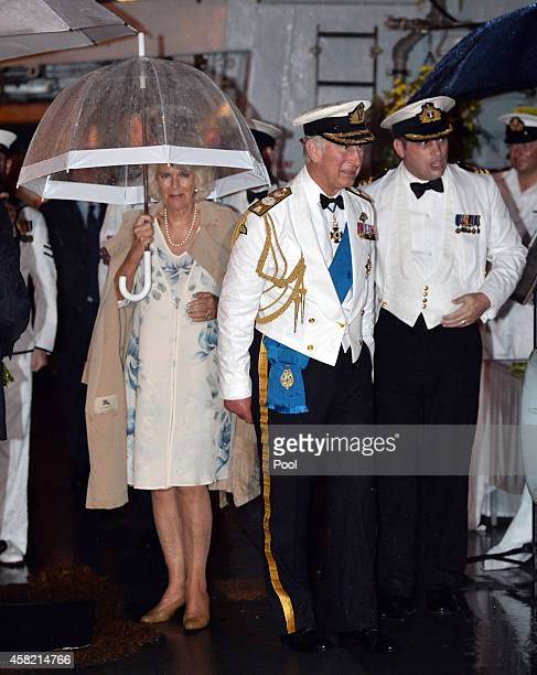 The Prince of Wales Admiral of the Fleet and The Duchess of Cornwall arrive for a Sunset Ceremony and Reception on board HMS Argyll on Day 4 of their...