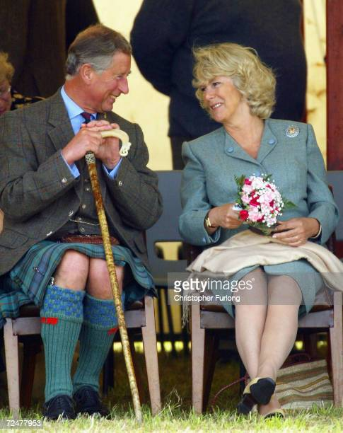 The Prince of Wales and Camilla Parker Bowles enjoy a lighter moment during the tug of war at the 2004 Mey Games at Queens Park in Mey on August 7...