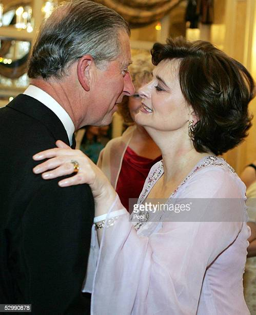 The Prince of Wales and Cherie Blair greet each other with a kiss at the Asian Women Of Achievement Awards at the London Hilton on May 26, 2005 in...