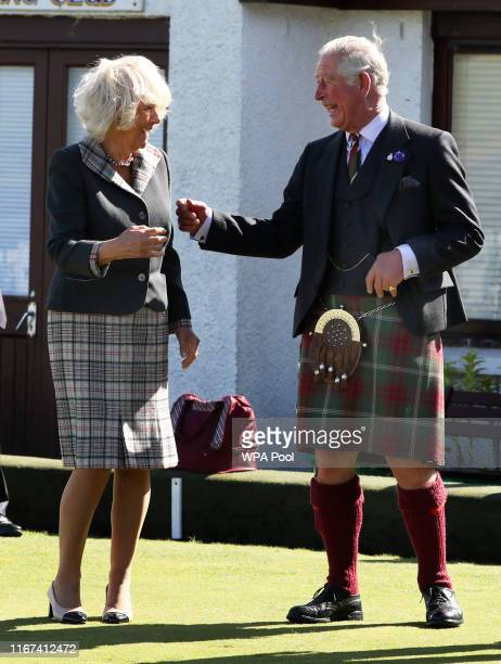 The Prince of Wales and Duchess of Cornwall known as the Duke and Duchess of Rothesay when in Scotland try lawn bowls during a visit to the coastal...