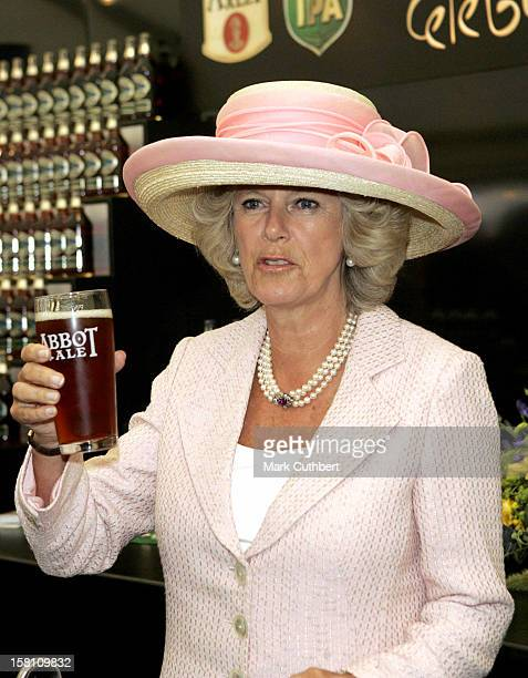 The Prince Of Wales And Duchess Of Cornwall Visit Bury St Edmonds And Lavenham In Suffolk During Their Visit They Pulled A Pint Of Bitter And Met...