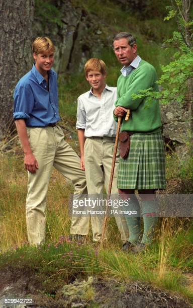 The Prince of Wales and his sons Prince William and Prince Harry pose for photographers above the Falls of Muick, during their traditional Balmoral...