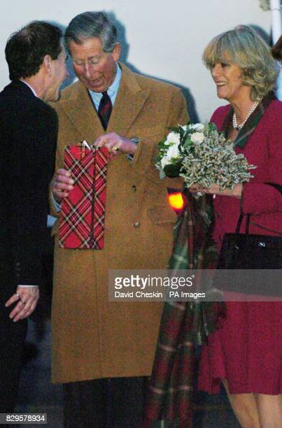 The Prince of Wales and the Duchess of Cornwall are given a wedding present on their arrival at Aberdeen airport as they make their way to start...