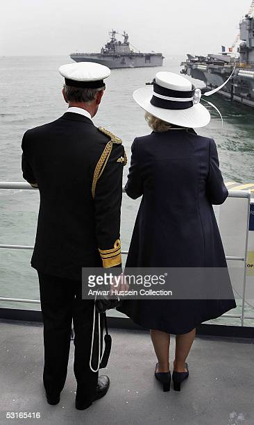 TRH The Prince Of Wales and The Duchess Of Cornwall are pictured at the fleet review on the deck of HMS Scott during the 200th Anniversary of the...