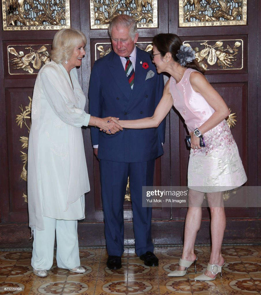 The Prince of Wales and the Duchess of Cornwall greet actress Michelle Yeoh as they arrive for a reception at the Pinang Peranakan Mansion, Malaysia, on the latest leg of their tour of the Far East.