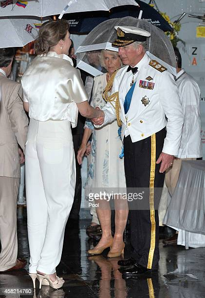 The Prince of Wales and the Duchess of Cornwall greet the First Lady of Colombia Maria Clemencia Rodriguez Munera at a Sunset Ceremony and Reception...