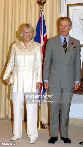 The Prince of Wales and the Duchess of Cornwall smile for the cameras during a visit to the Pakistani Prime Minister's official residence in...