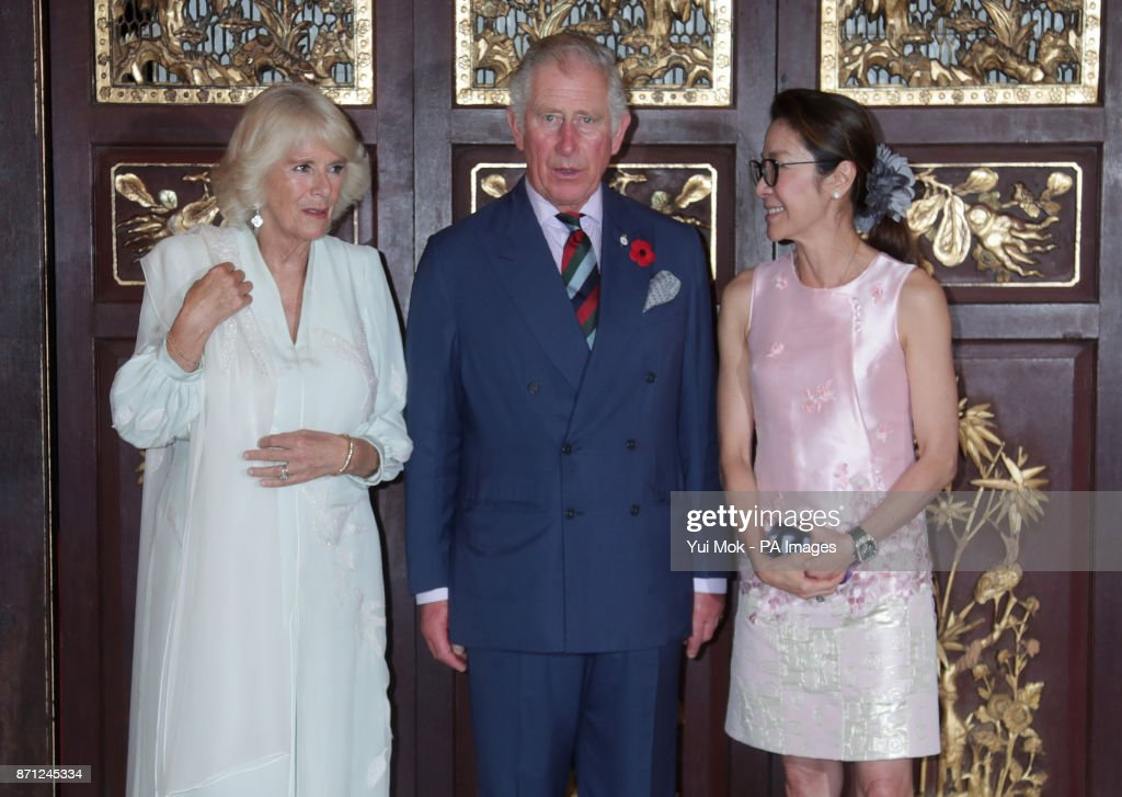 The Prince of Wales and the Duchess of Cornwall with actress Michelle Yeoh as they arrive for a reception at the Pinang Peranakan Mansion, Malaysia, on the latest leg of their tour of the Far East.