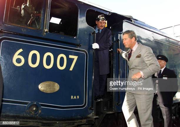 The Prince of Wales at Pickering Station on the North Yorkshire moors after travelling on the Sir Nigel Gresley steam train built in 1936