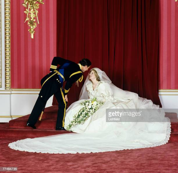 HRH The Prince of Wales bending towards HRH The Princess of Wales after their wedding in the Throne Room at Buckingham Palace on 29th July 1981