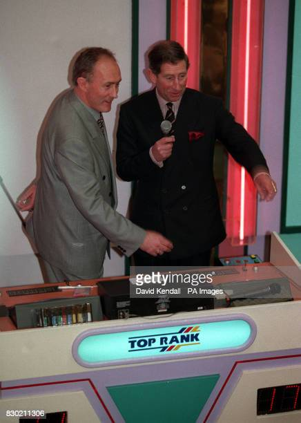 The Prince of Wales call out the numbers helped by Bingo caller Terry Jobson during a visit to the Top Rank Bingo Hall in Chester The Prince accepted...