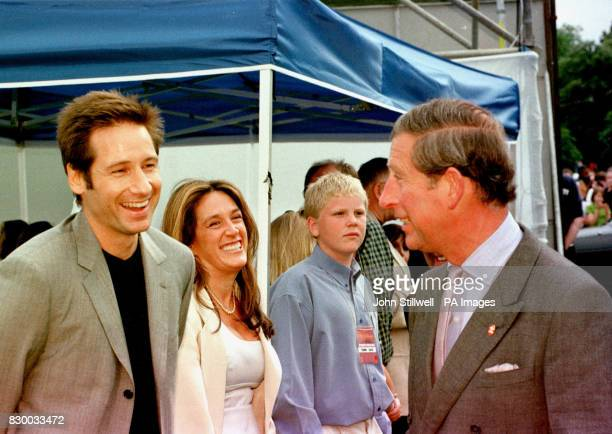 The Prince of Wales chats to American actor David Duchovny during today's Party in the Park in aid of the Prince's Trust