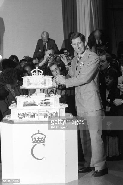 The Prince of Wales cuts the birthday cake made for him at a huge party to celebrate his 40th birthday today in a once derelict tramshed in Birmingham