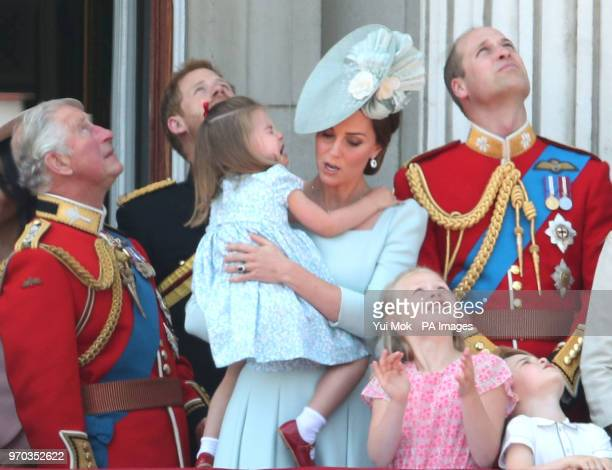 The Prince of Wales, Duke of Sussex, Duchess of Cambridge holding Princess Charlotte and Duke of Cambridge with Savannah Phillips and Prince George...