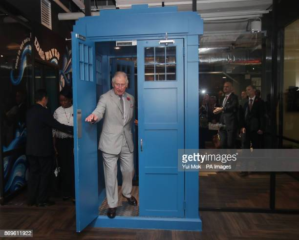 The Prince of Wales enters through a door shaped in the style of Dr Who's Tardis during his visit to Worq Coworking space for Young Entrepreneurs in...