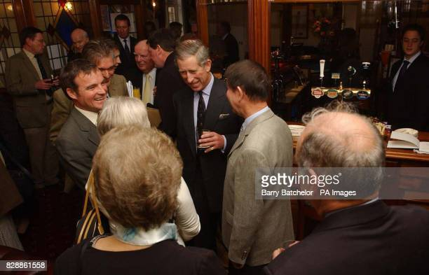 The Prince of Wales has a drink in the Poet Laureate pub in Poundbury Dorset during a visit to the area The Prince was in Poundbury to open Hammick...