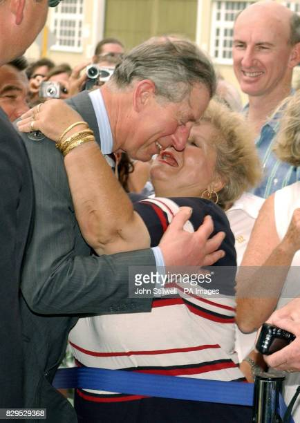 The Prince of Wales hugged and kissed by Esperance Vanderham as he arrives at the Maritime Museum at Freemantle Harbour in Western Australia