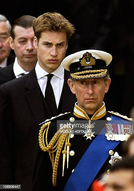 The Prince of Wales is followed by his son Prince William during the gun carriage procession from Westminster Hall for the funeral service of Queen...