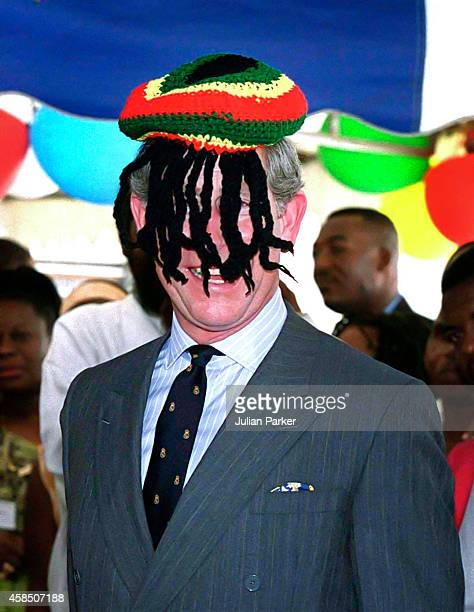 The Prince of Wales is presented with a Rasta Cap by Bob Marley's widow Rita at Trenchtown community centre in Kingston Jamaica on February 29 2000...