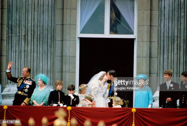 The Prince of Wales kisses his new bride on the balcony of Buckingham Palace The Prince and Princess of Wales greet the huge crowd after their...