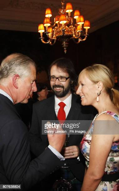 The Prince of Wales known as the Duke of Rothesay in Scotland meets Harry Potter author J K Rowling and her husband Dr Neil Murray during a reception...
