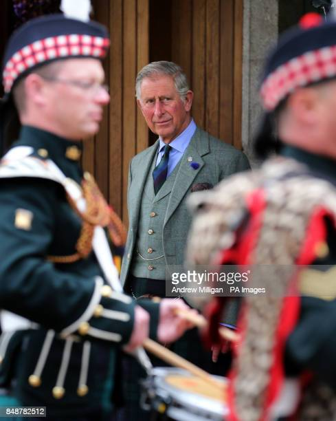 The Prince of Wales known as the Duke of Rothesay when in Scotland watches the Pipes and Drums of the 7th Battalion The Royal Regiment of Scotland at...