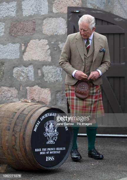 The Prince of Wales known as the Duke of Rothesay while in Scotland is presented with a cask of whisky which he filled and sealed 30 years ago which...