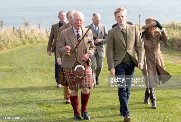 The Prince of Wales, known as the Duke of Rothesay while in Scotland, is accompanied by castle owner George Pearson , during a visit to Dunnottar...