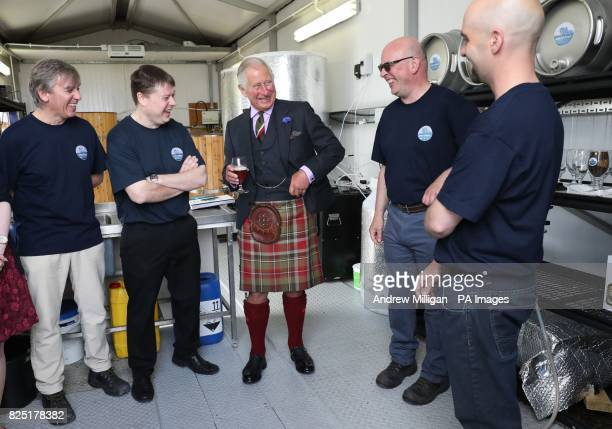 The Prince of Wales known as the Duke of Rothesay while in Scotland tries a pint of Swelkie Golden Ale with coowners Alan Farquhar Andrew Mowat John...