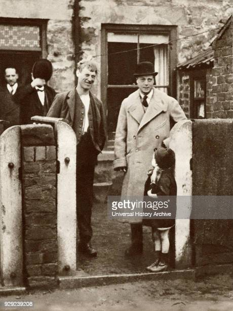 The Prince of Wales, later King Edward VIII visiting a miner's house and family in Durham in 1929. From The Story of 25 Eventful Years in Pictures...