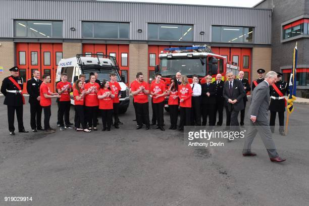 The Prince of Wales laughs following a group photograph with staff and students during a visit to Dearne Community Fire Station on February 16 2018...