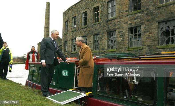 The Prince of Wales leaves the canal boat after a trip on the Leeds Liverpool Canal in Burnley