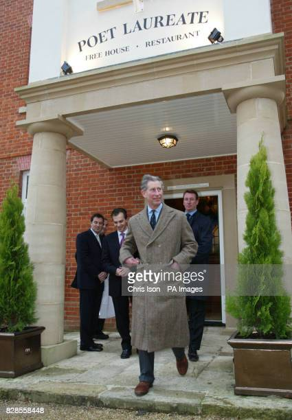The Prince of Wales leaves the Poet Laureate pub after sampling a pint of beer during his visit to the village of Poundbury in Dorset *The Prince...