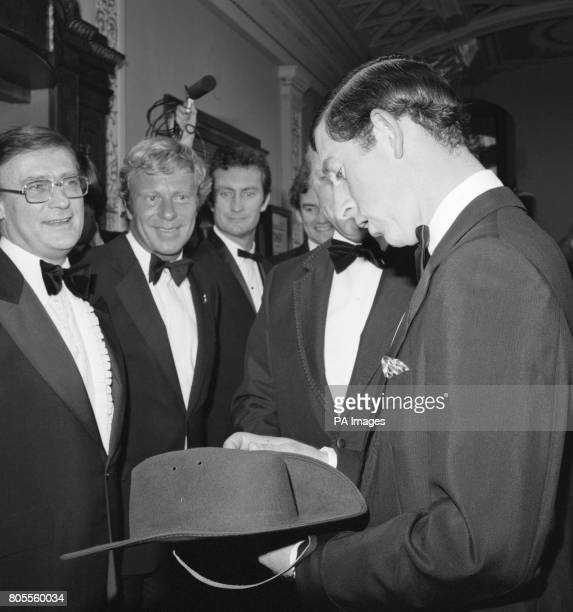 The Prince of Wales looks at a 'bush hat' at the Classic Cinema in Haymarket London when he attended the Royal Gala Charity Premiere of the film...