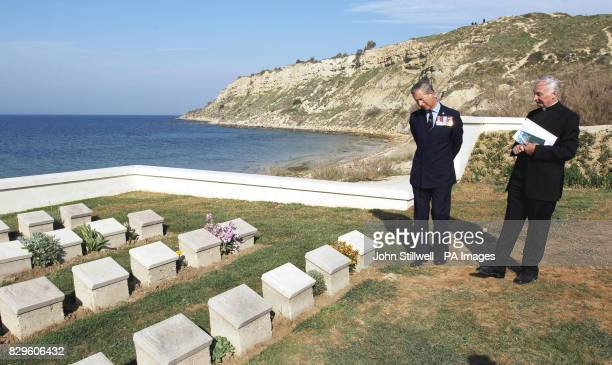 The Prince of Wales looks at gravestones with Rev Geoffrey Evans Chaplin to the British Embassy in Turkey