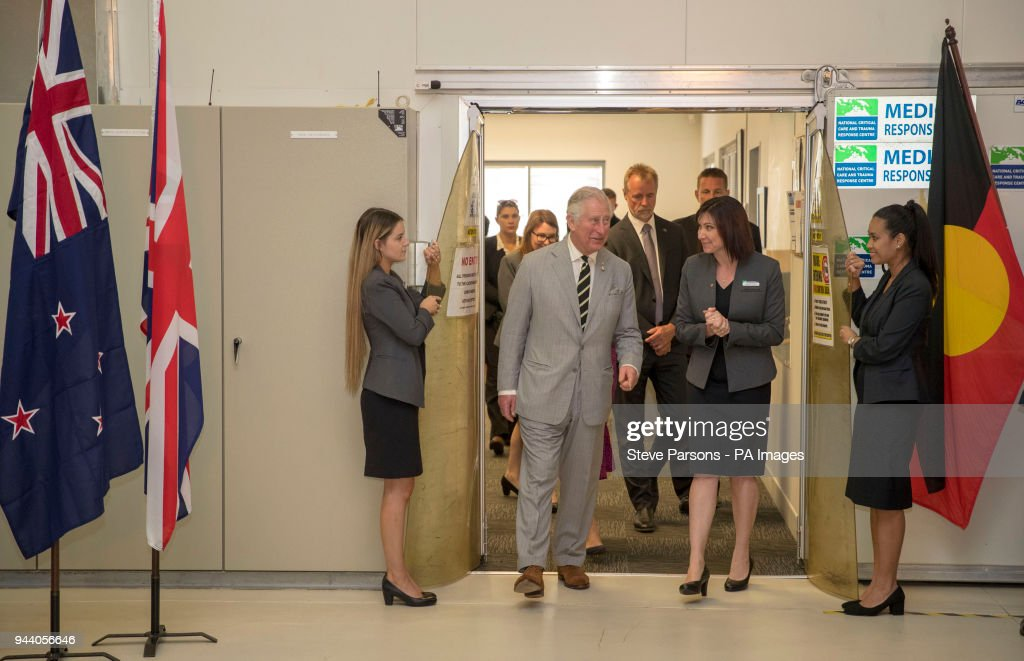 The Prince of Wales looks at medical supplies during a visit to the