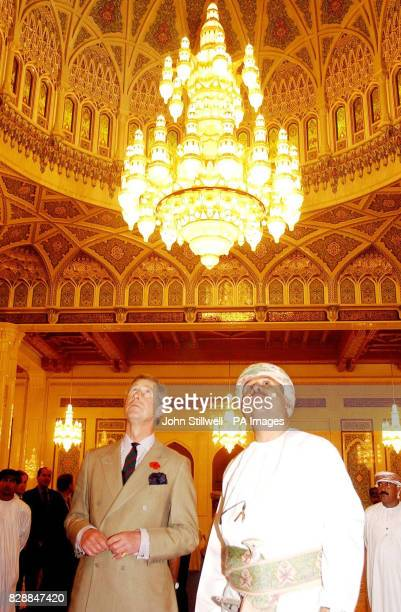 The Prince of Wales looks up to the magnificent and gigantic chandelier with Dr Khalan bin alSiabia in the Sultan Qaboos Mosque The Prince visited...