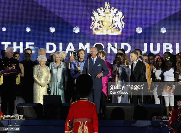 The Prince of Wales makes a speech as HM Queen Elizabeth II The Duchess of Cornwall Sir Paul McCartney Gary Barlow and artists listen on stage during...