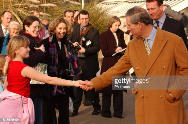 The Prince of Wales meets a visitor at Kew Botanical Gardens west London * The Prince was opening the Nash Conservatory a 19th century glasshouse...
